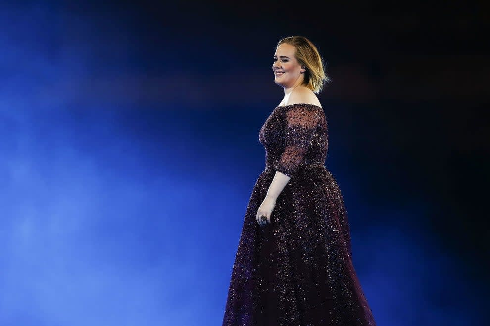 Adele performs at ANZ Stadium in a shimmery off-the-shoulder dress