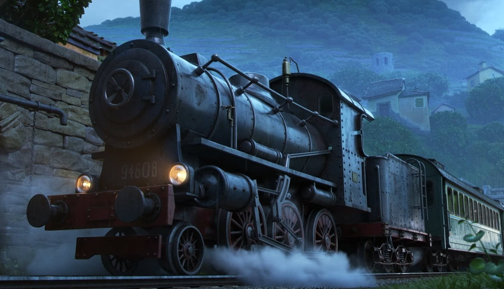 A steam engine standing at a station.