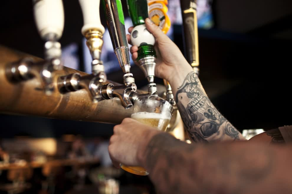 bartender pouring beer
