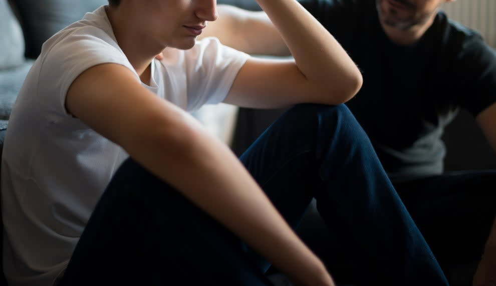 A teen and parent in distress during a conversation