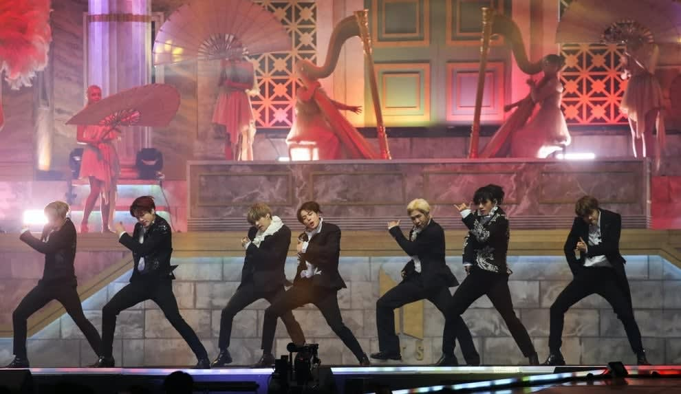 BTS performs in suits on a stage designed to look like a temple