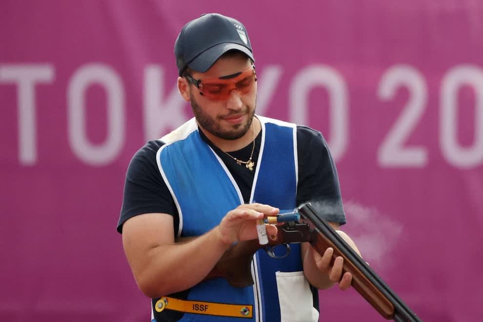 A shooter wearing orange sunglasses while loading his gun