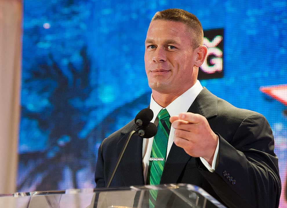 John Cena pointing to the camera at a press event