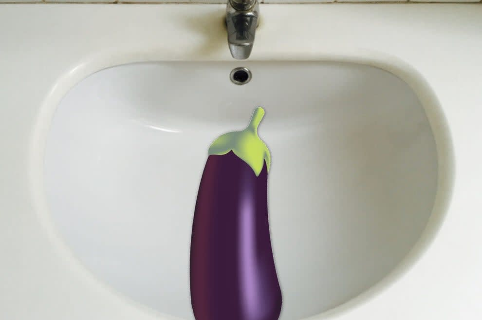 eggplant emoji over a sink