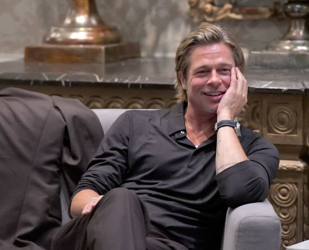 A shot of Brad Pitt with his hand on his face