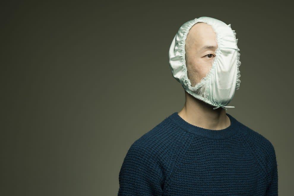 man with silk underwear on his head