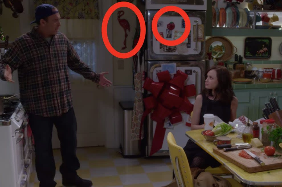 The flamingo and apple magnet circled in Lorelai's kitchen