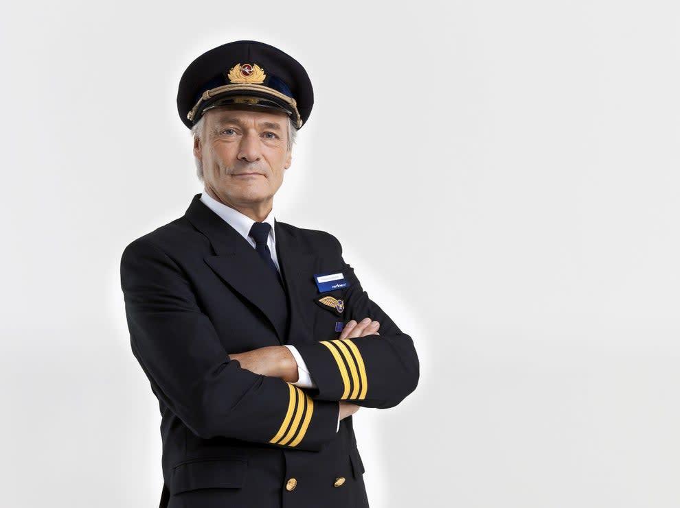An older an in a pilot uniform