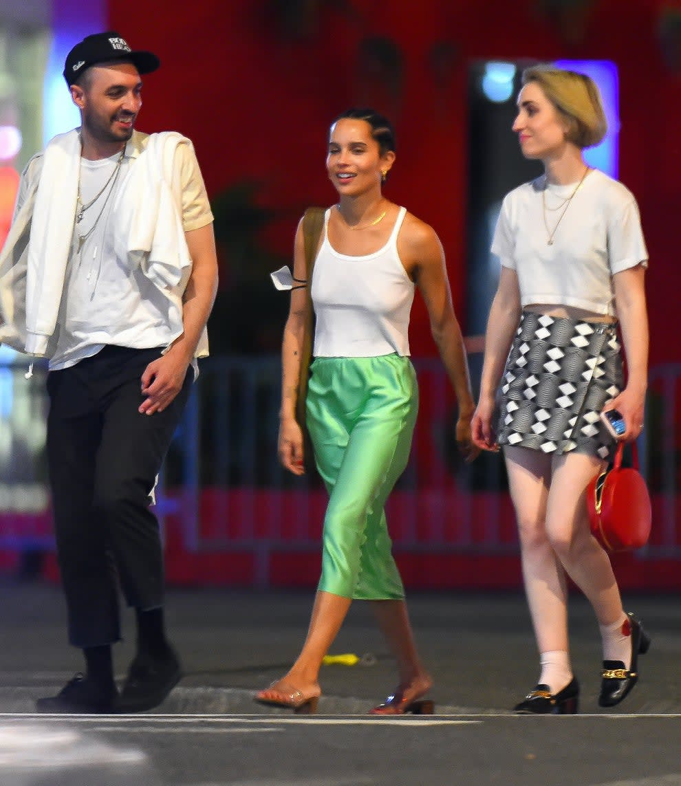 Zoe with friends on the NYC streets wearing tank, skirt, and slides