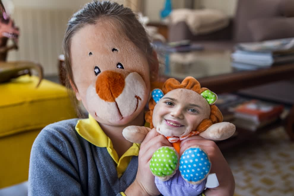 kid with their face swapped with their toy