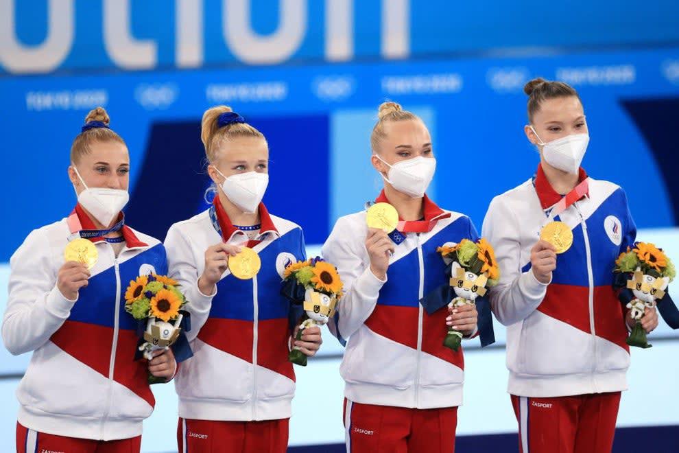 Gold medallists Lilia Akhaimova, Viktoria Listunova, Andgeina Melnikova, and Vladislava Urazova (L-R) of the ROC team pose at a victory ceremony for the women's artistic gymnastics team all-around event