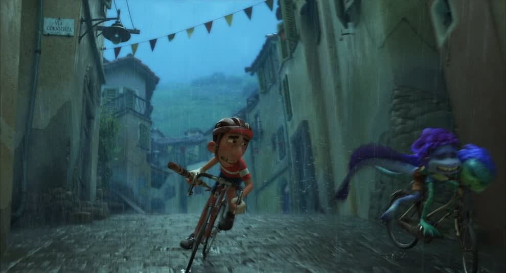 A man on a bike overtakes two sea monsters riding another bike.