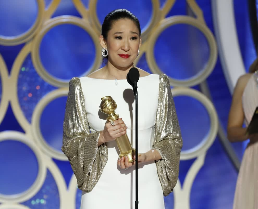 """Sandra Oh on stage accepting her Golden Globe Award for Best Actress in a Drama Series for """"Killing Eve"""""""