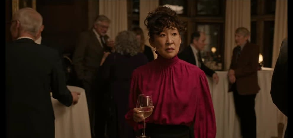 Ji-Yoon holding drink at faculty party