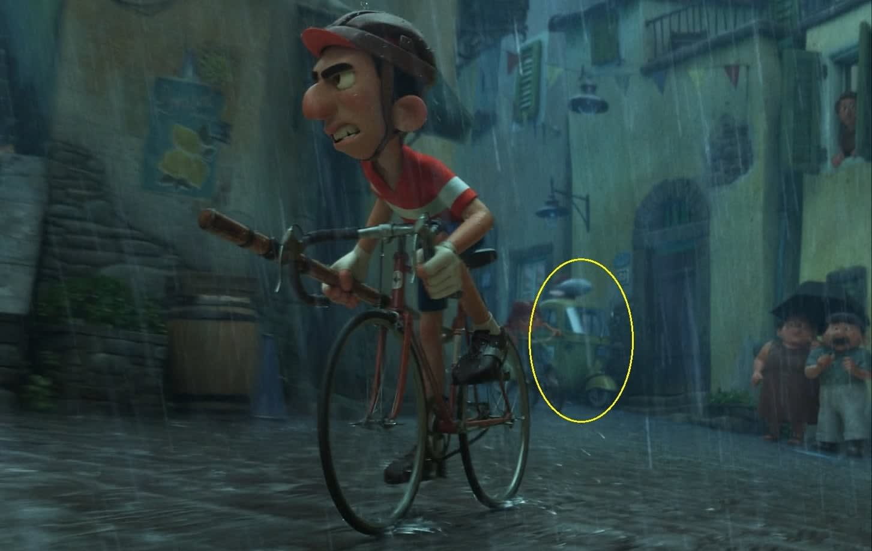 A man racing on a bike while it rains.