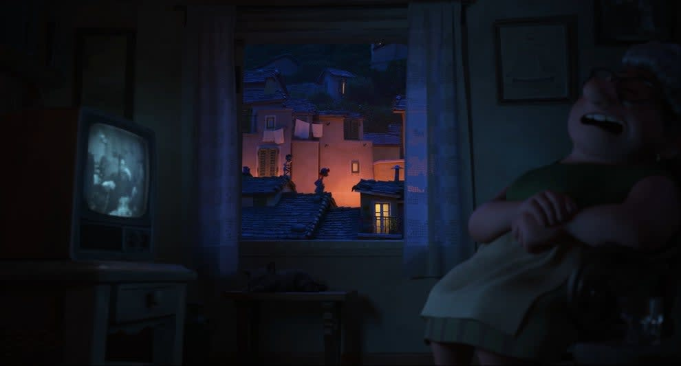 A woman is sleeping in front of a TV while two kids walk on rooftops outside her window at night