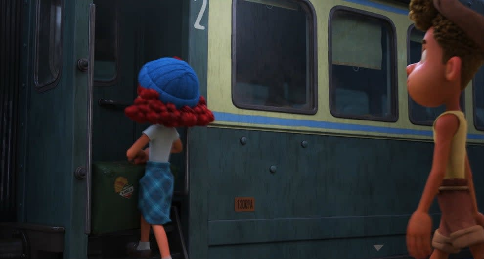 A redhaired girl boards a train.