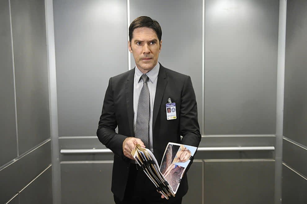 """Thomas Gibson wearing a suit in an elevator on """"Criminal Minds"""""""