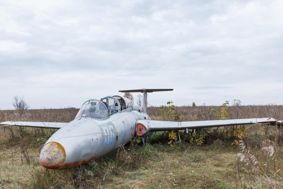A plane crashed in the middle of a field