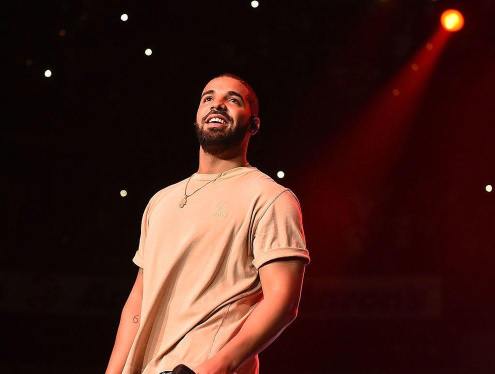 Drake performing onstage