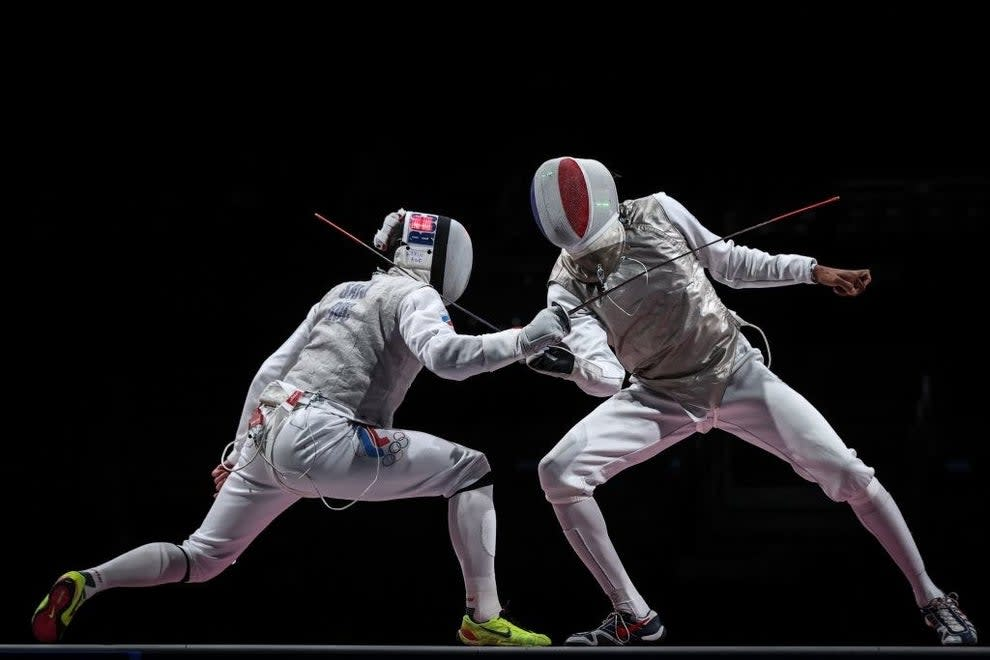 Two fencers fighting