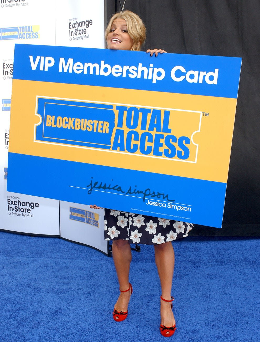 jess simpson with a giant blockbuster card