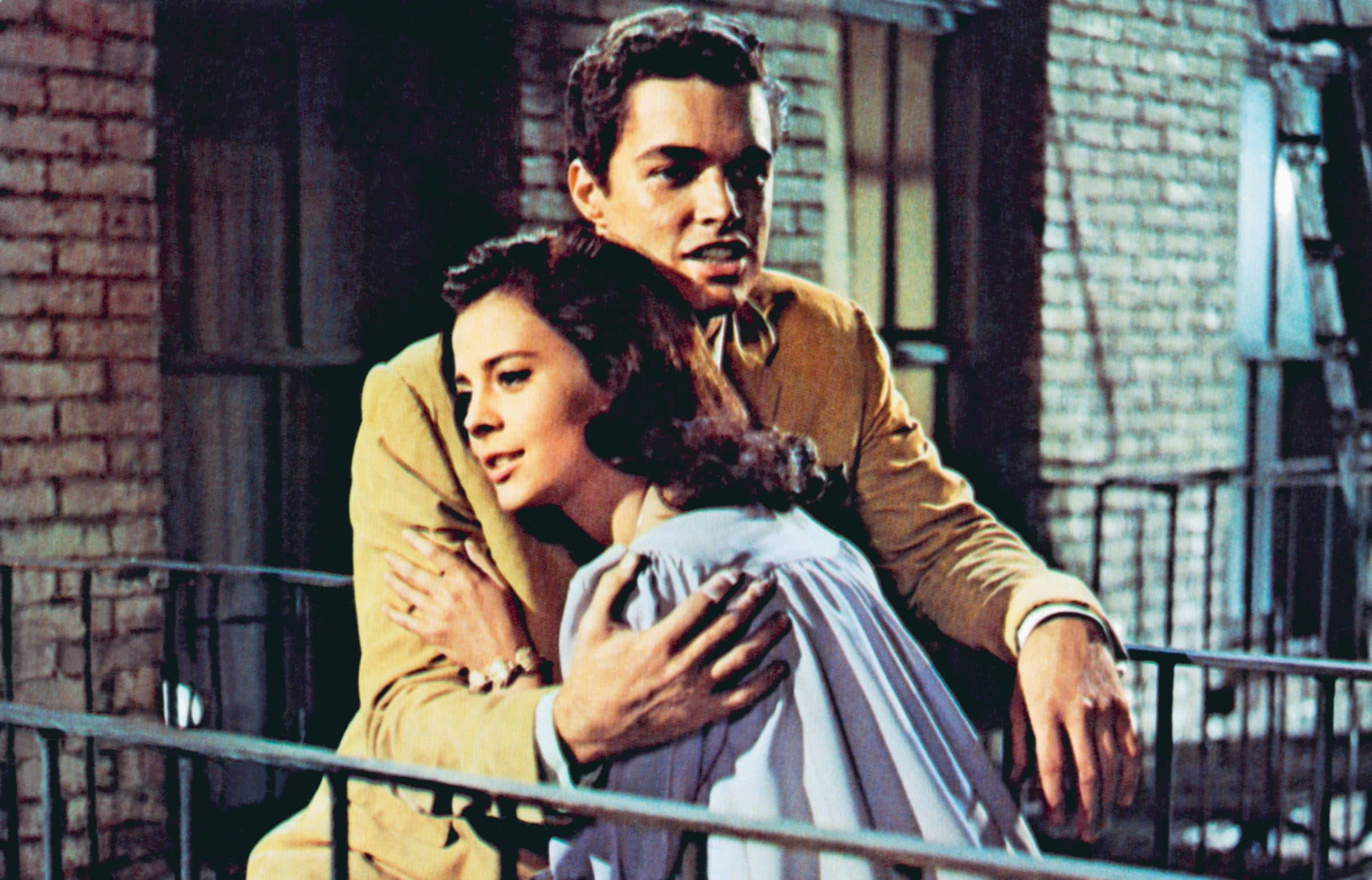 Natalie Wood as Maria in West Side Story hugging Tony.