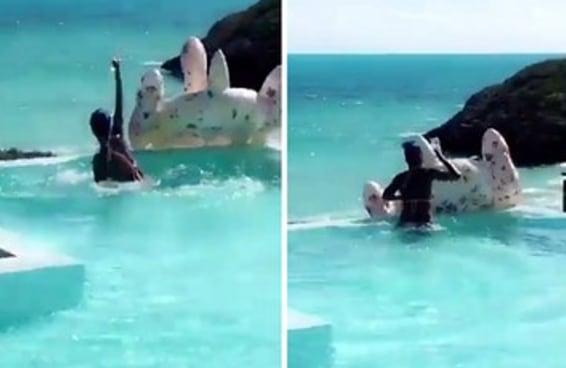 Rihanna foi gente como a gente ao impedir seu vinho de cair na piscina