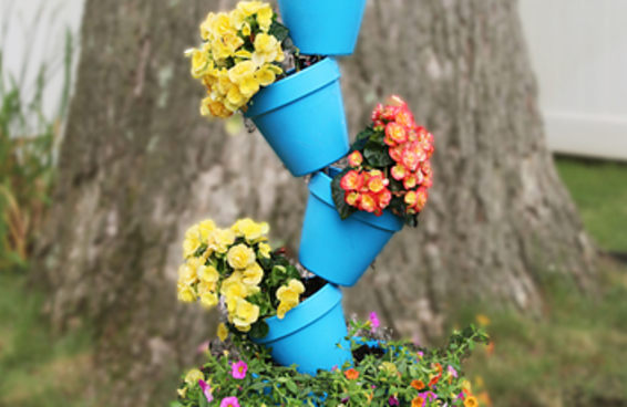 Este suporte para vasos de plantas vai dar um belo toque em seu jardim