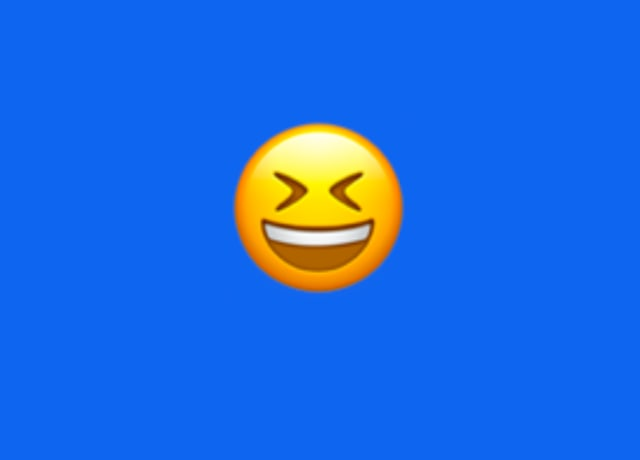 An emoji squinting and laughing