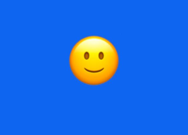 An emoji smiling softly