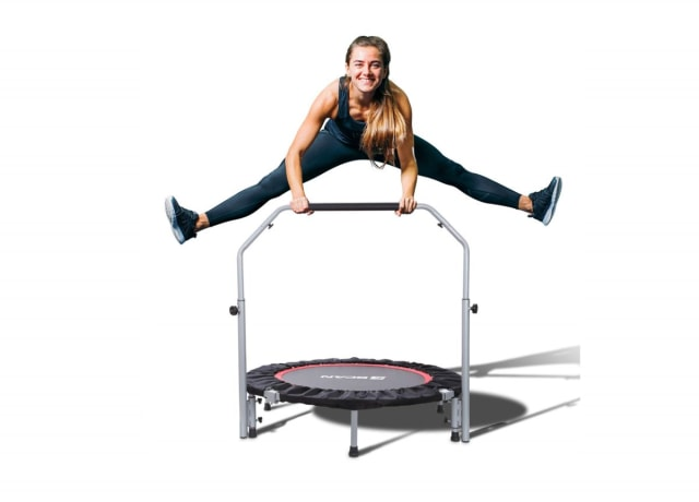 Sporty young woman jumping on a mini trampoline