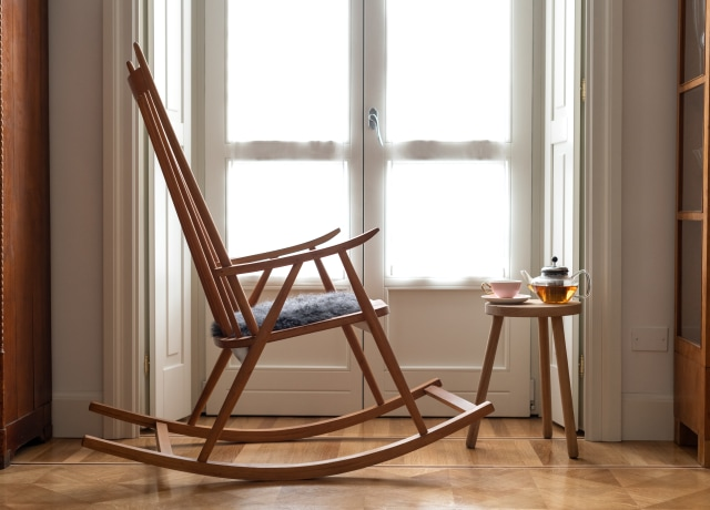 brown wooden chair near window