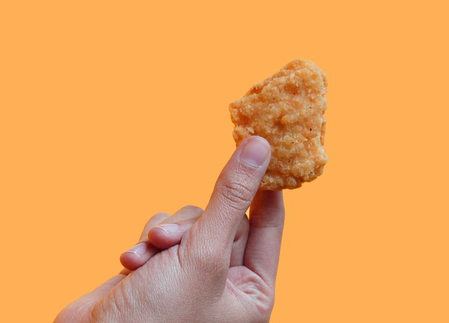 person holding biscuit