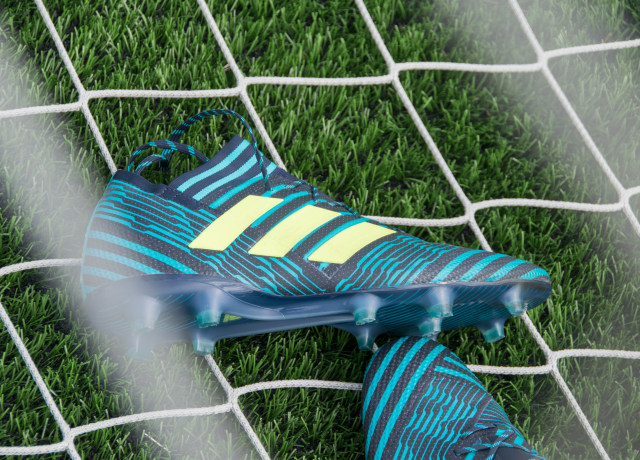 pair of blue-black-and-beige Adidas cleats