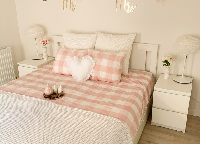 white and pink bed sheet