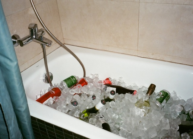 assorted beverage bottle in bathtub