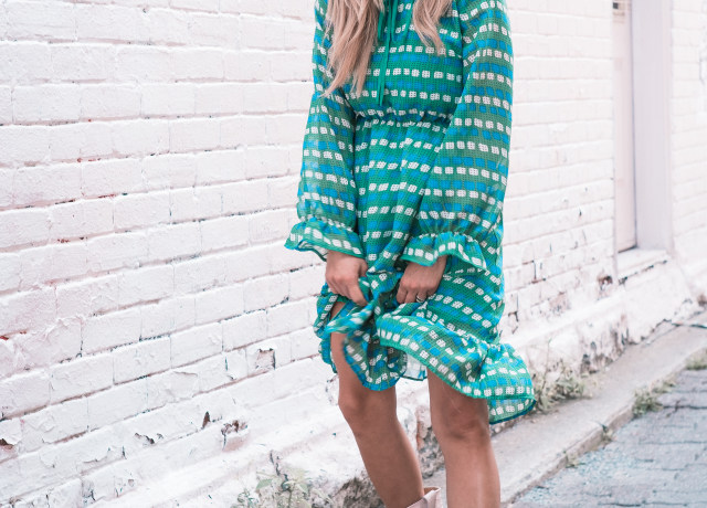woman wearing teal and white long-sleeved dress