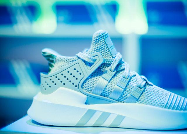 unpaired gray adidas sneaker