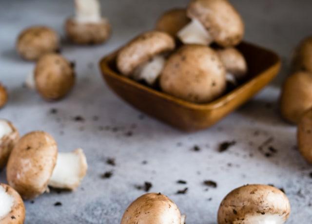 brown mushrooms on gray surface