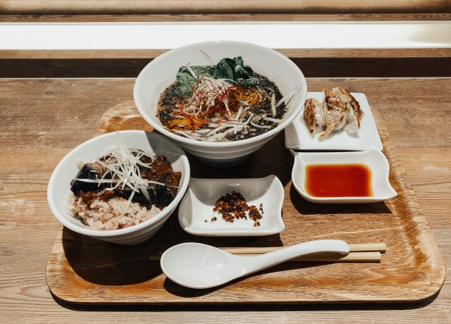 white ceramic bowl with food on brown wooden table