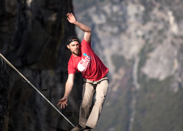 man waking on rope