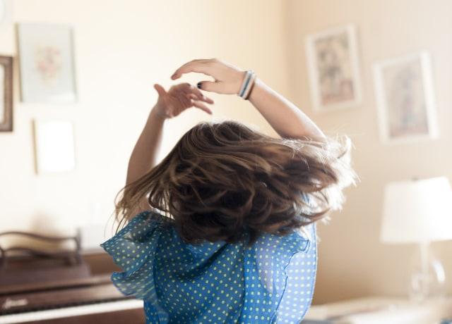 girl twirling around room
