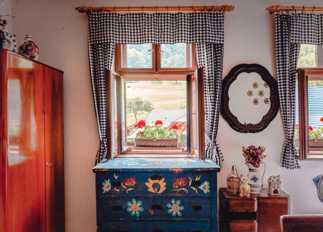 blue wooden dresser with mirror