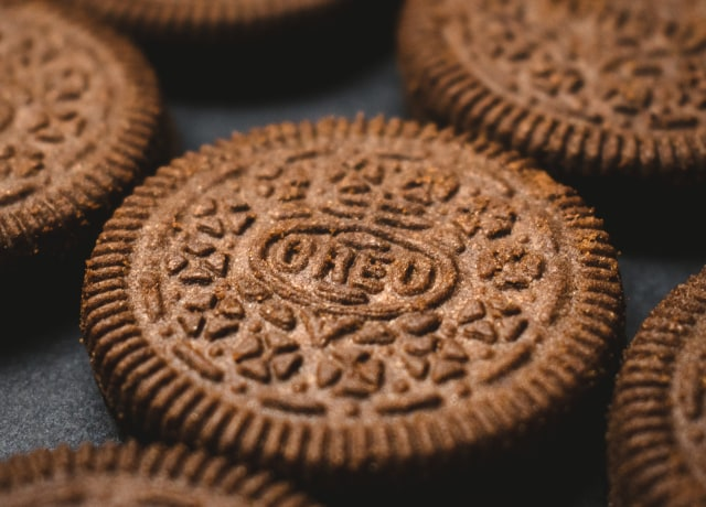 brown cookies on black textile