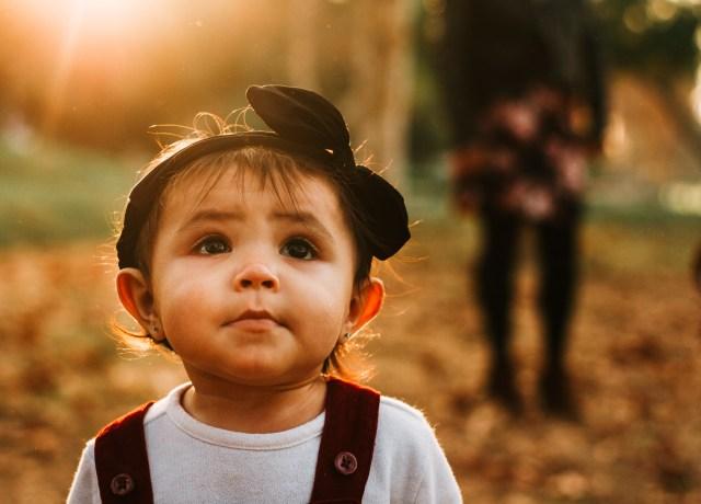 toddler wearing black headband