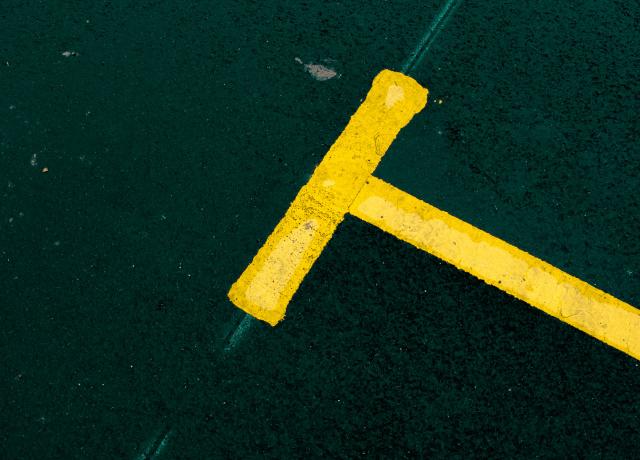 yellow metal tool on green textile