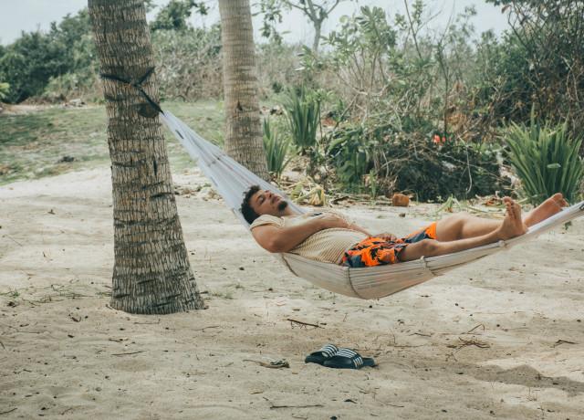 man sleeping on hammock