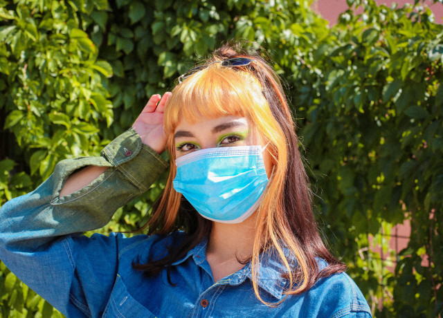 girl in blue denim jacket with blue face paint