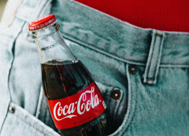Coca-Cola glass bottle on pocket